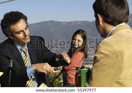 two men talking while a girl is looking at - stock photo