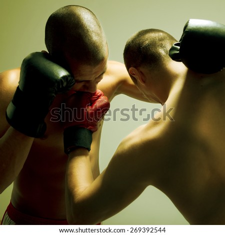 Two men with boxing glove fighting - stock photo