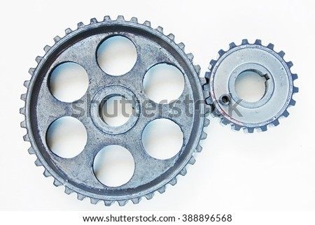 Two metal cogwheels on the light background - stock photo