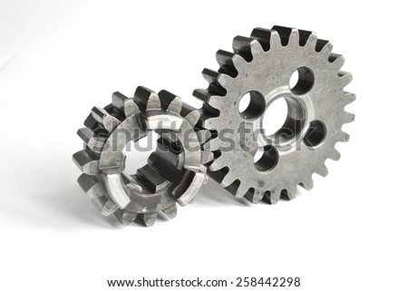 Two metal gears on the white background. - stock photo