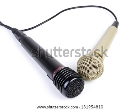 Two microphones with a cord isolated on a white background.