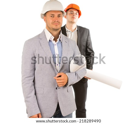 Two Middle Age Male Engineers in Black and Gray Attire Holding Blueprints While Looking at Camera. Isolated on White Background. - stock photo