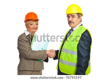 two middle aged architects shaking hands  for an agreement isolated on white background - stock photo