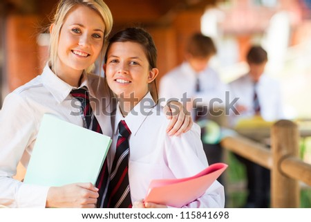 two middle school girls portrait on campus - stock photo
