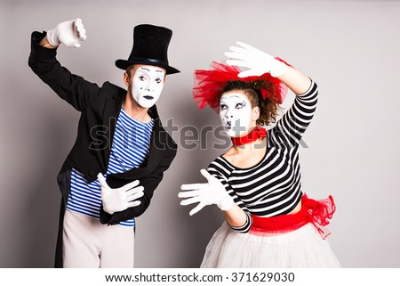 Two mimes man and  woman, April Fools Day concept - stock photo