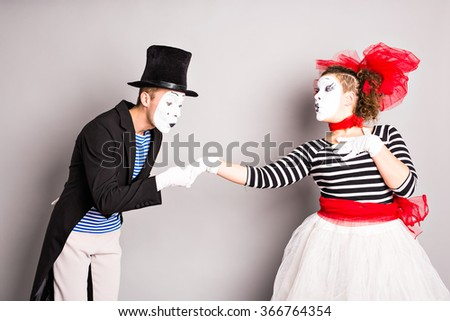 Two mimes man and  woman.The concept of Valentine's Day, April Fool's Day - stock photo