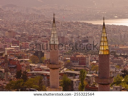 Two minarets in the Turkish port city of Izmir - stock photo
