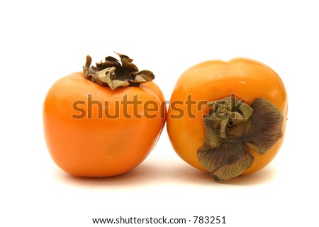 Two mini persimmons on a white background and surface