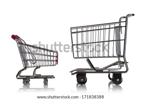 Two miniature shopping carts on a white tabletop