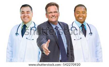 Two Mixed Race Doctors Behind Businessman Reaching for a Hand Shake Isolated on White.