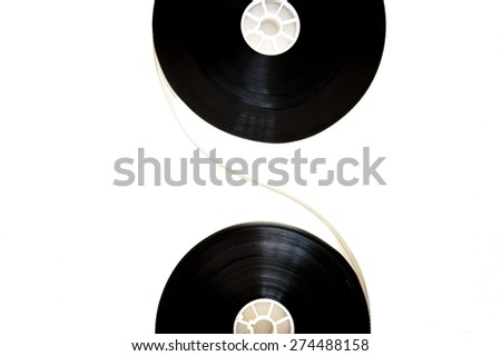 Two 35mm cinema reels connected with filmstrip isolated on white background - stock photo