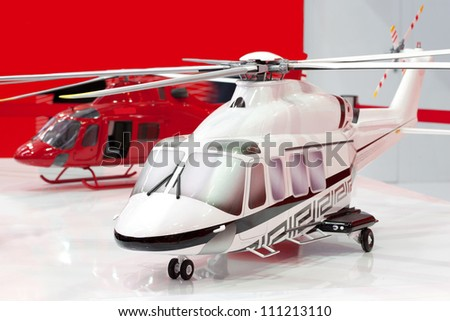 Two models of helicopters - stock photo