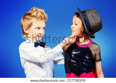 Two modern kids posing together. Fashion shot.   - stock photo