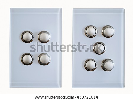 two modern light switches on a white background - stock photo