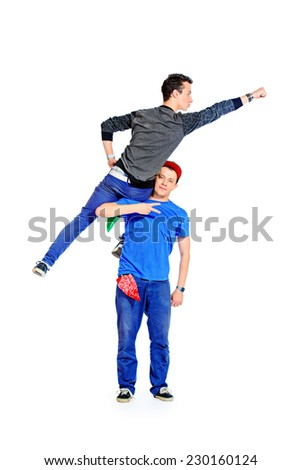 Two modern male dancers at studio. Superman concept. Isolated over white. - stock photo
