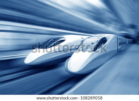 two modern train speeding with motion blur. - stock photo