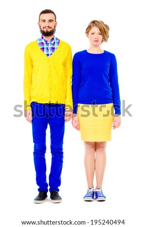 Two modern young people standing together and smiling. Full length. Isolated over white. - stock photo