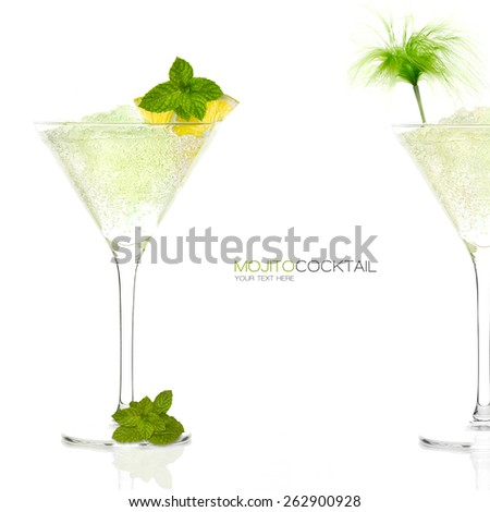 Two Mojito cocktails garnished with lemon and mint in a tall stemmed conical martini glasses with ice conceptual of a tropical vacation, nightclub or celebration on white background with sample text - stock photo
