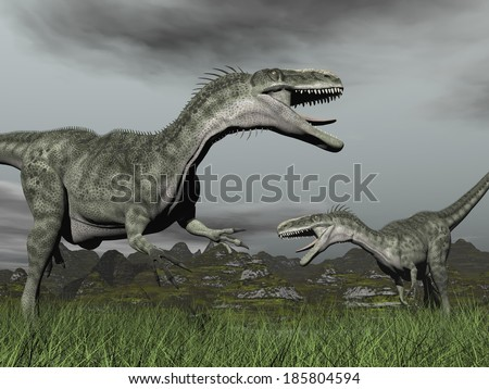 Two monolophosaurus roaring at each other in grassy landscape by cloudy day - stock photo