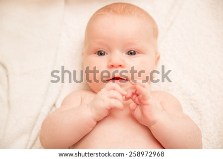 Two-month old baby girl on a light background - stock photo