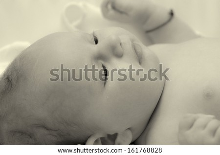 two months old baby girl black and white sepia toning portrait - stock photo
