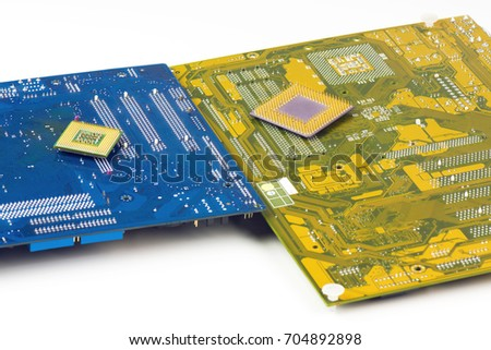 Two Motherboards And Processors On White Background