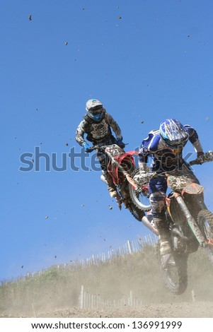 Two motocross bikes in mid air