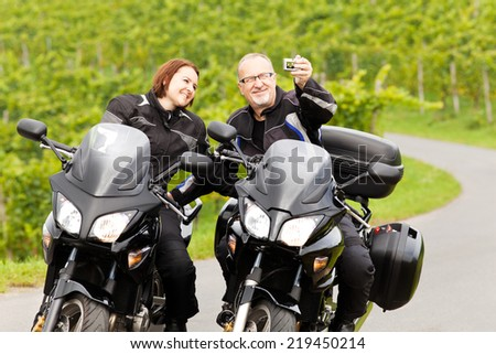 Two motorcyclists taking a Selfie - stock photo