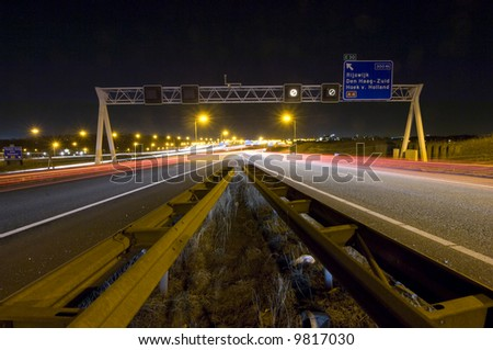Two motorway lanes merging into one - stock photo