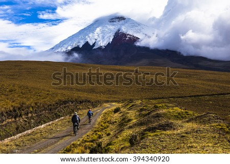 Two mountain bikers riding in the Cotopaxi National Park, Ecuador. - stock photo