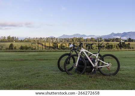 Two mountain bikes in the early morning on a farm. - stock photo