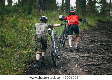 two mountainbiker in a uphill race - stock photo