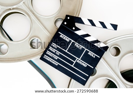 Two movie reels for 35 mm film projector with clapper board and filmstrip on neutral background - stock photo