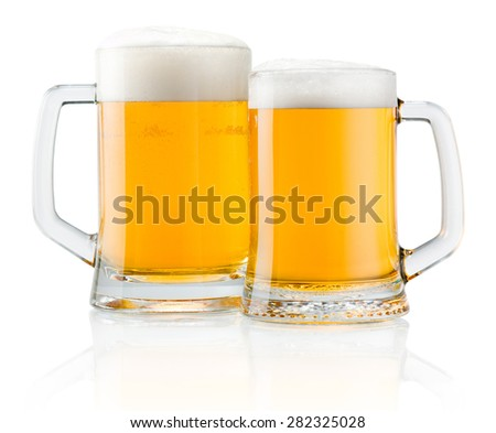 Two mug of fresh beer with cap of foam isolated on white background - stock photo