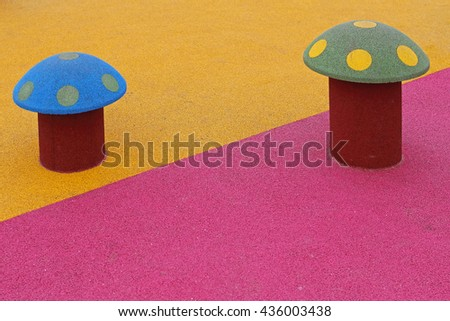 Two Mushrooms at Colourful Playground For Children - stock photo