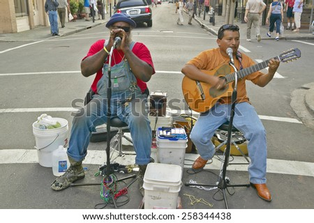 Two musicians perform in street of French Quarter near Bourbon Street in New Orleans, Louisiana - stock photo