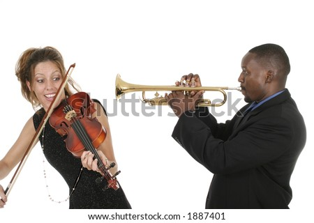 Two musicians play around with each other as they tune their instruments and prepare for a concert. - stock photo