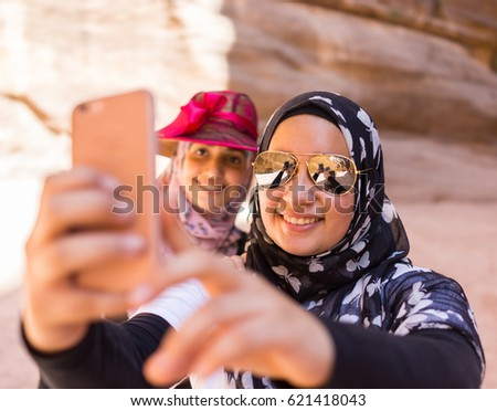 Two Muslim Arabic girls taking a selfie during travel