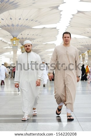 Two Muslim men walking together - stock photo
