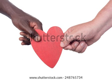 Two muti racial men holding a valentine wooden heart - stock photo