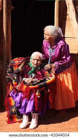 Two Navajo Women in Front of Their Family Traditional Hogan Hut