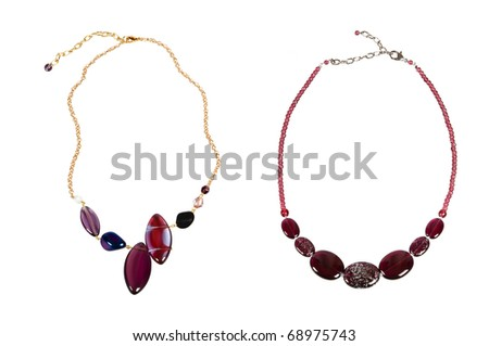 two necklaces with red wine beads over white - stock photo