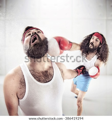Two nerdy guys boxing - stock photo