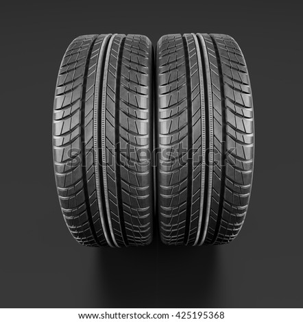 Two new car tires close up on black background. 3d illustration - stock photo