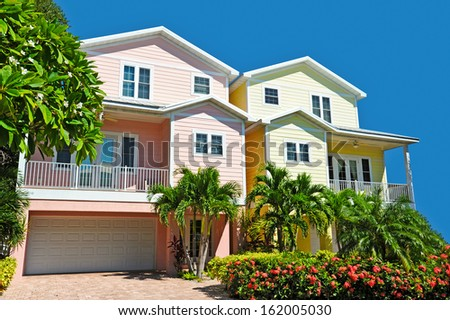Two New Colorful Landscaped Beach Houses - stock photo