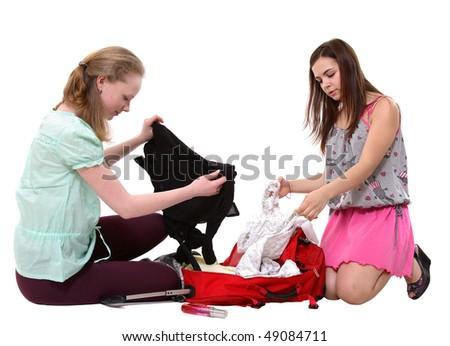 Two nice girls with suitcase on a white background - stock photo