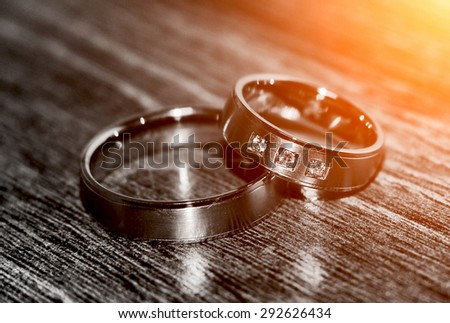 Two nice wedding rings. Love concept background.  - stock photo