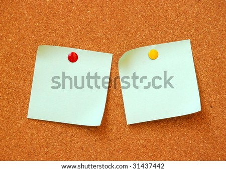 two note pads on cork board