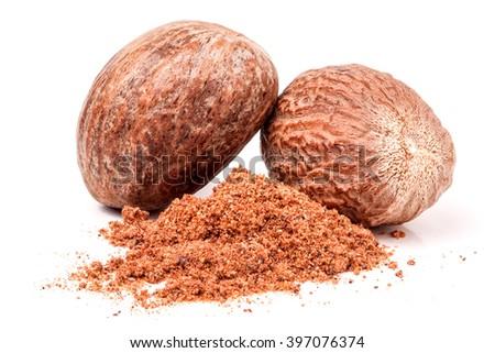Two nutmeg whole  isolated on white background - stock photo
