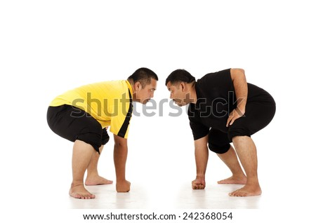 Two obesity man playing sumo - stock photo
